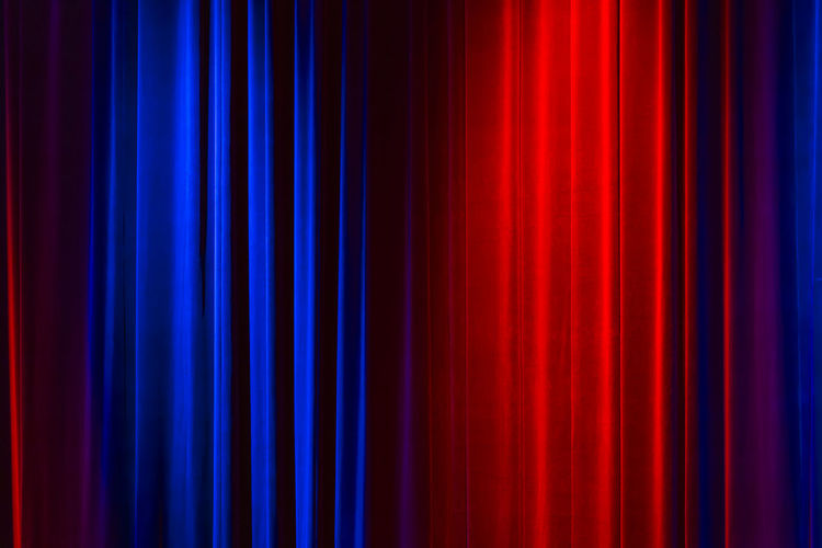 Red and blue light on curtain