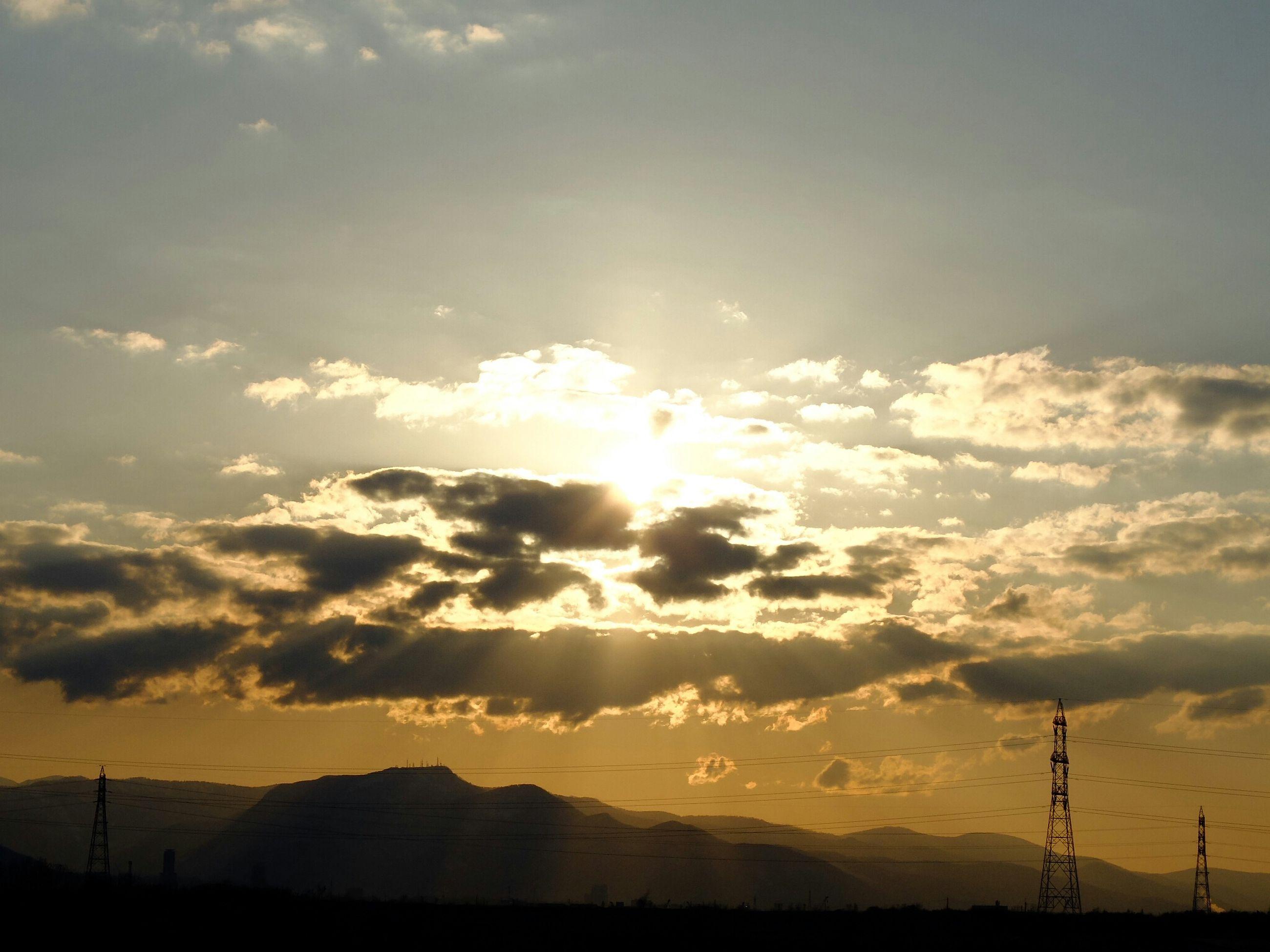 sunset, scenics, tranquil scene, tranquility, sky, beauty in nature, silhouette, landscape, sun, nature, idyllic, electricity pylon, cloud - sky, orange color, power line, mountain, sunlight, sunbeam, cloud, non-urban scene