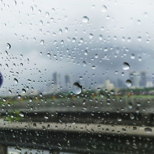 Drop Window Rain Wet Glass - Material Water Full Frame Backgrounds RainDrop No People Weather Close-up Indoors  Day Airplane Sky Nature Cityscape Rainy Days Rainycity The Week On EyeEm