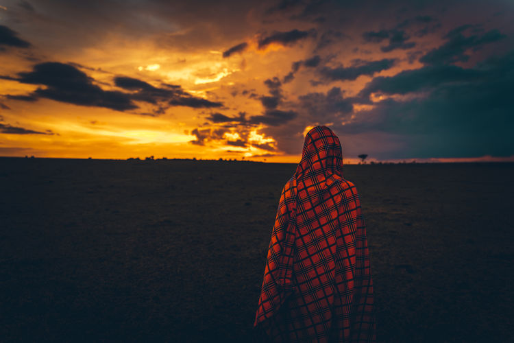 Fiery sunsets ! Sky Sunset Cloud - Sky Beauty In Nature Land One Person Orange Color Lifestyles Real People Nature Leisure Activity Women Rear View Tranquility Scenics - Nature Tranquil Scene Looking At View