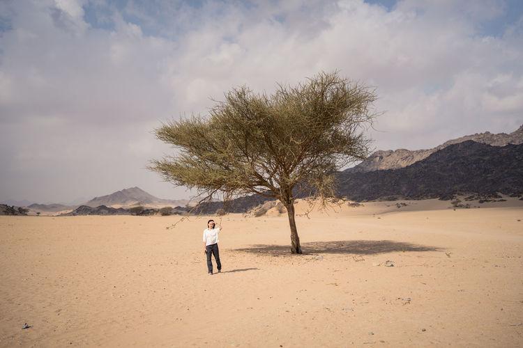 Man on desert against sky