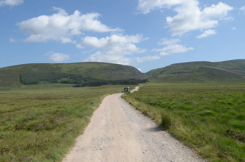Day Exploring Grass Hill Landscape Mountain Nature Outdoors Pathway Remote Road Scenics The Way Forward Tranquil Scene