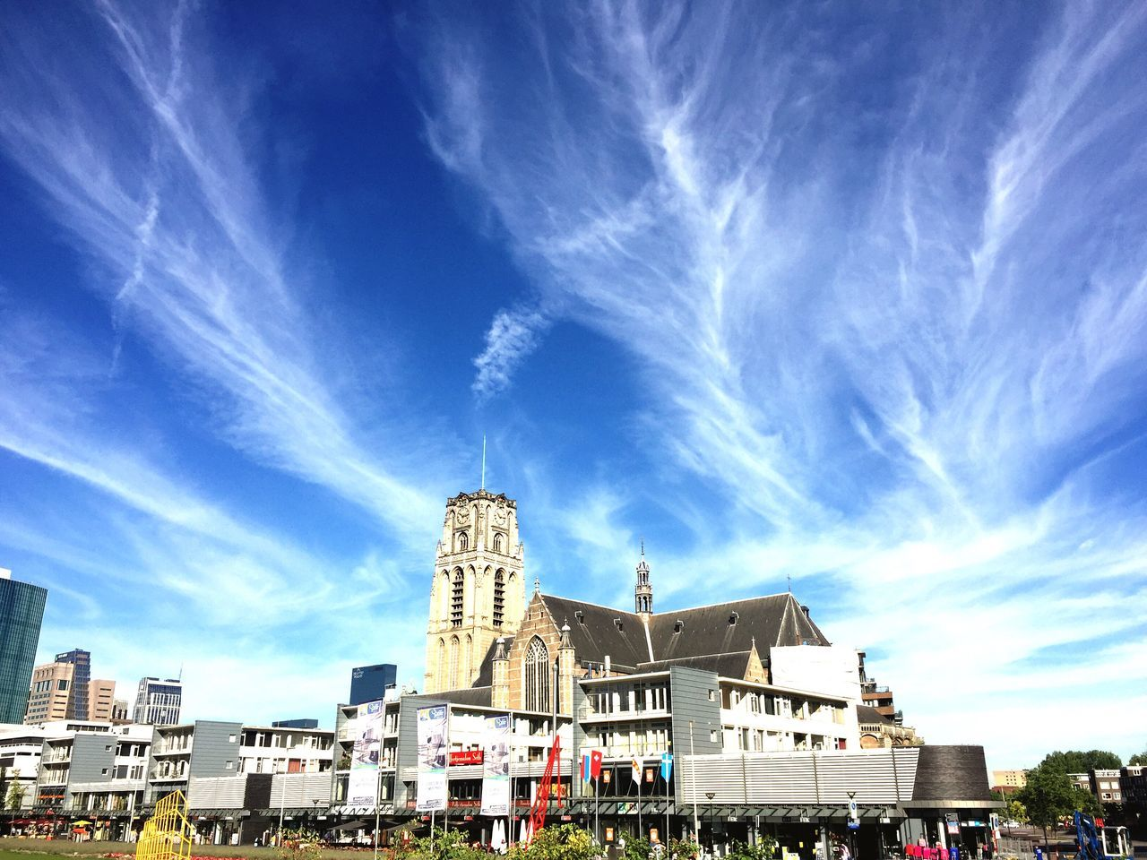 architecture, building exterior, built structure, sky, cloud - sky, blue, city, day, outdoors, travel destinations, sunlight, spirituality, large group of people, cityscape, people
