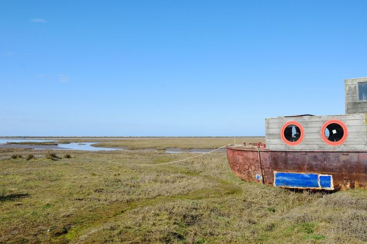 Wooden Houseboat in estuary norfolk Houseboat House Boat Norfolk Norfolk Uk Single Object Marshland  Escaping Lonely Quiet Landscape Grass Scenics - Nature Outdoors