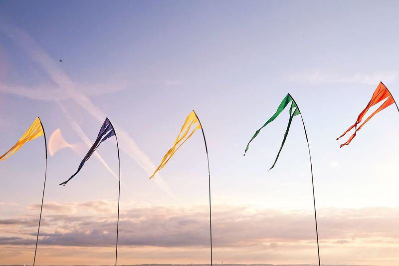 Sky Blowing Flags Open Space Full Frame Backgrounds Windy Day Textile Rainbow Colors Blue Flag Green Flag Yellow Flag High Up In The Sky  Sky Low Angle View Cloud - Sky Nature No People Flag Multi Colored In A Row Side By Side Hanging Pole Wind Environment Outdoors Sunset