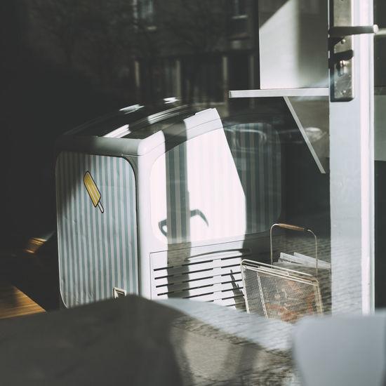 Freezer Seen Through Glass Door Of Shop