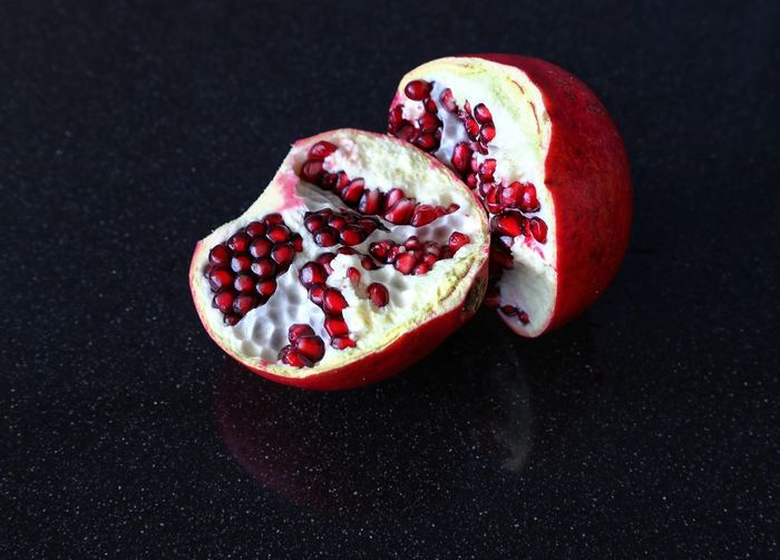 Close-up of pomegranate against black background