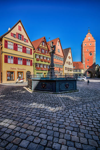 Don't be shady and always treat people like it is their heyday! Germany No People Travel Destinations Outdoors Wide Angle View TOWNSCAPE Town Life Cityscape Creative Shots Creative Photography CreativePhotographer Architecture Architecture_collection Europe Europe Trip Multi Colored Colourful Dinkelsbuhl Bavaria In The Shade Sunny Day Blue Sky Street Photography Street Life European Architecture