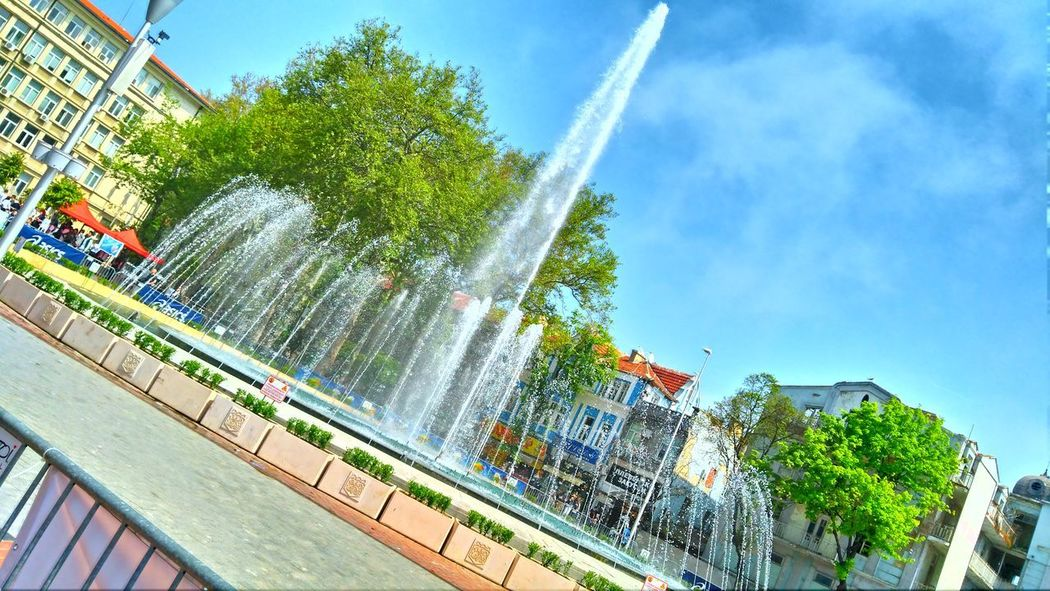 The fountan of independency Fountain Spraying Tree Sky Water Motion Day Outdoors Architecture City EyeEmNewHere EyeEm EyeEmPaid Randomshot Summer Bulgaria❤️ Low Angle View View Point Good Mood Great Day  Personal Perspective Freshness Hot