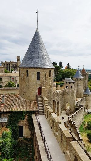 Architecture Built Structure Sky Cloud - Sky History Place Of Worship Cloudy Outdoors Town Famous Place Ancient Civilization Ancient Castle Tower Fort Carcassonne Carcassone, France Old Old Buildings France Stone Material Spire  The Past Roof First Eyeem Photo
