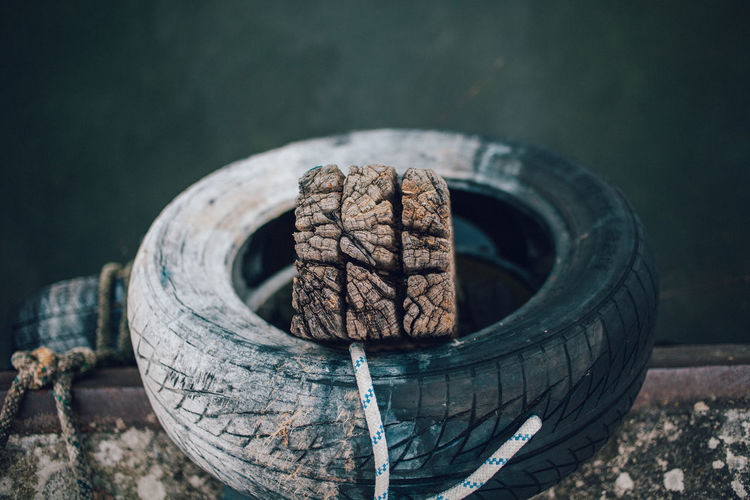 High angle view of weathered wood in tire