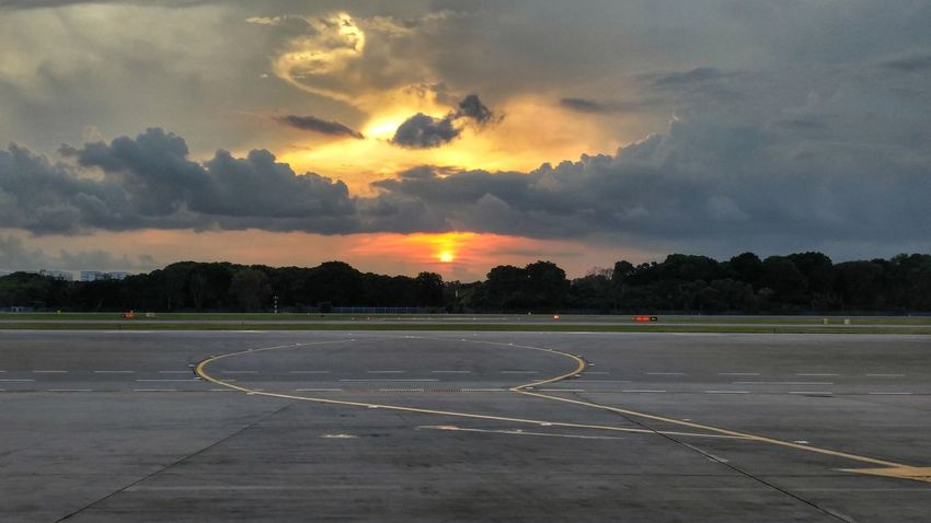 Red sun. Sunset Outdoors Beauty In Nature Cloudsandsky Airport Airport Runway Working Hard LGV10 Lgv10photography Hustle Red Orange Yellow Sky