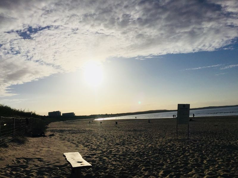 Sunset at the Beach Sky Cloud - Sky Water Land Scenics - Nature Tranquility Beach Nature Sunlight Tranquil Scene Sea Beauty In Nature Sand Sun Day Sunset No People Lens Flare Outdoors