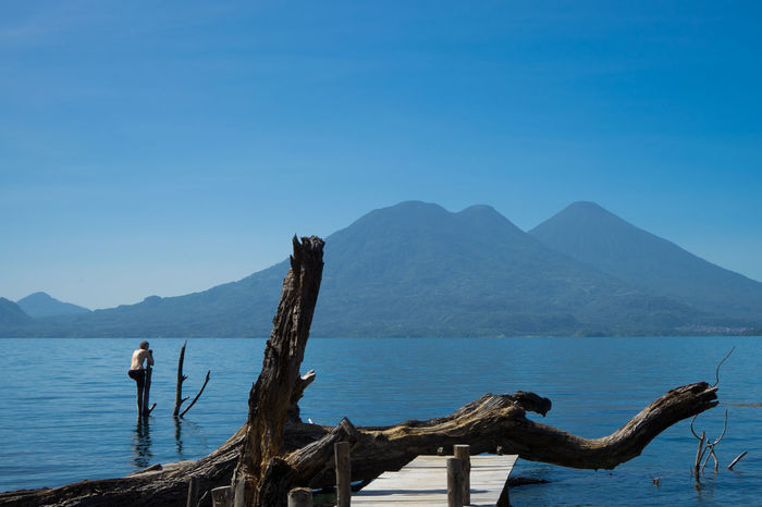 Atitlan Lake Guatemala Tranquility Atitlan Beauty In Nature Blue Clear Sky Day Guate Mountain Nature No Clouds One Person Outdoors Panajachel  People San Marco Scenics Sky Tranquil Scene Tranquility Volcano Vulcano Water Summer Exploratorium