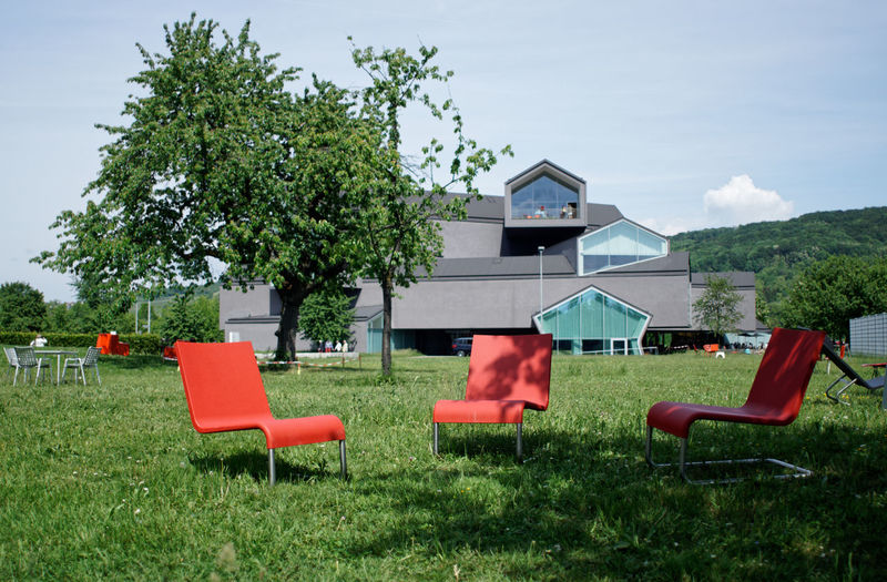 Architecture Vitra Design Museum Absence Architecture Building Building Exterior Built Structure Chair Day Field Grass Green Color Growth Land Nature No People Outdoors Plant Red Seat Sky Tree Vitra Campus The Architect - 2018 EyeEm Awards