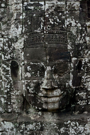 Buddha sculptures carved on temple wall