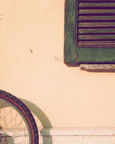 Cropped Image Of Bicycle Against Wall