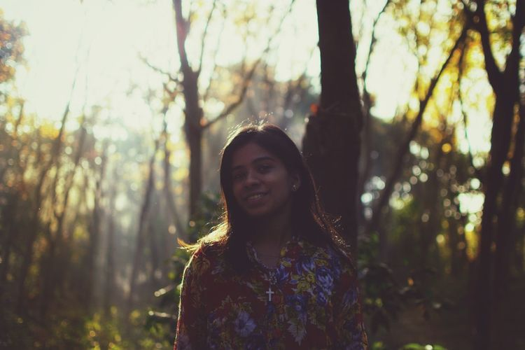 EyeEm Best Shots Morning Light And Shadow Nature Portrait Morning Light Abstract The Week On EyeEm 2018 Lady Smiling Only Women Adult Happiness One Woman Only One Person People Forest Tree Adults Only Cheerful Portrait Beautiful Woman Nature Outdoors Sunlight Young Adult Women Beauty Toothy Smile Fashion Stories Shades Of Winter