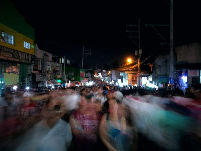 Crowd on illuminated city at night