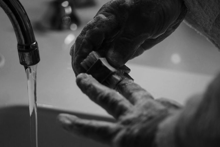 Cropped Image Of Man Washing Hands