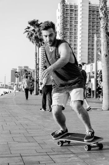 Casual Clothing City Cool Enjoying Life Enjoyment Gordonbeach Leisure Activity Lifestyles One Person Outdoors Real People Skateboard Skill Telavivbeach Telavivcity Young Adult Youonlyliveonce The Street Photographer - 2017 EyeEm Awards The Portraitist - 2017 EyeEm Awards Blackandwhite Blackandwhite Photography Streetphotography Streetphoto_bw Black And White Friday