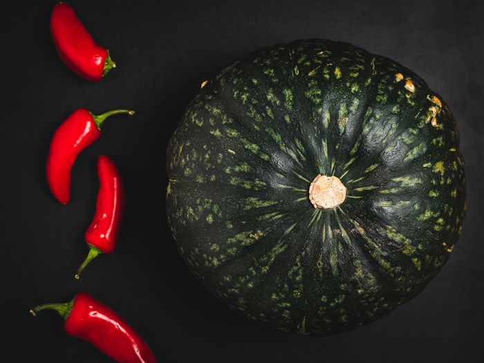 High angle view of chili pepper against black background
