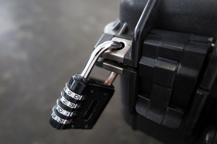 Close-up of locked suitcase