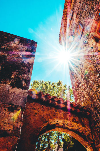 Architecture Beauty In Nature Building Exterior Built Structure Close-up Day Lens Flare Low Angle View Multi Colored Nature No People Old Buildings Old Street Outdoors Sky Stone Material Stone Wall Sun Sunbeam Sunbeams Sunflare Sunlight Sunlight Sunrays Tree