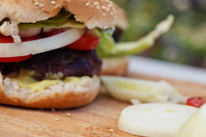 Cropped image of burger on cutting board