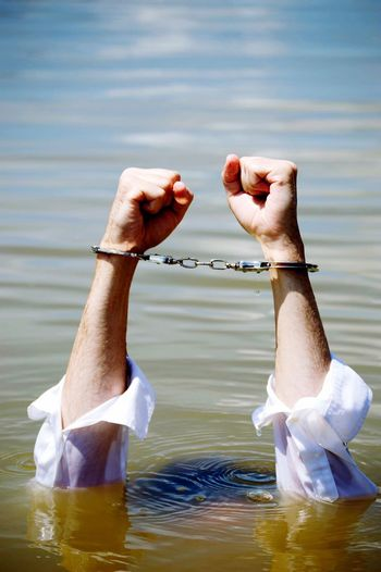 Handcuffs Man Drowning In Lake