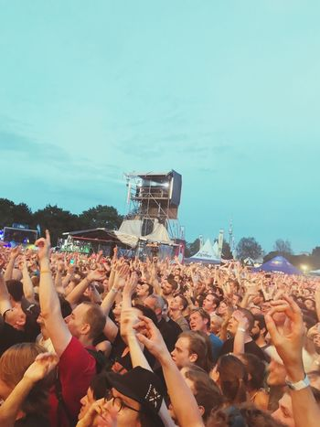 Large Group Of People Crowd Music Arts Culture And Entertainment Music Festival Enjoyment Audience Fan - Enthusiast Leisure Activity Togetherness Popular Music Concert Arms Raised Excitement Fun Spectator Women Cheering Performance Men Real People