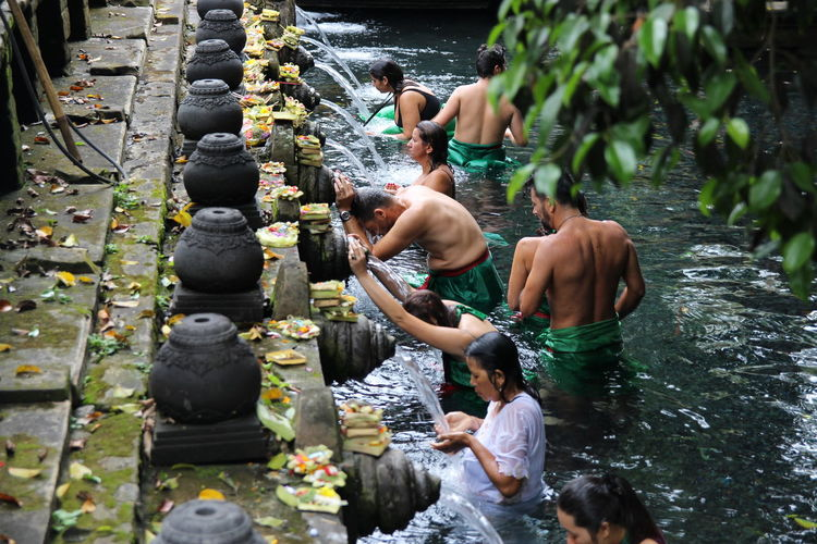 People waiting for bath in fountain at temple