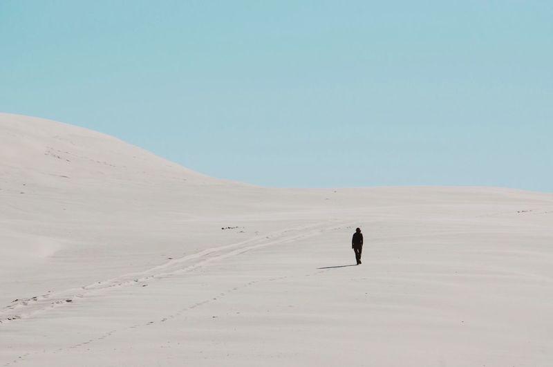 Rear View Of Man Walking At Desert