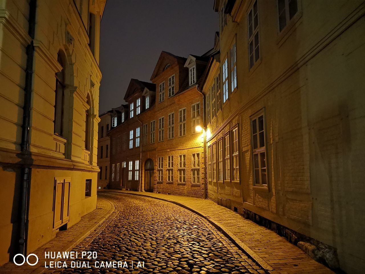 architecture, building exterior, built structure, building, street, illuminated, city, residential district, lighting equipment, window, the way forward, direction, no people, night, cobblestone, nature, outdoors, street light, empty, alley