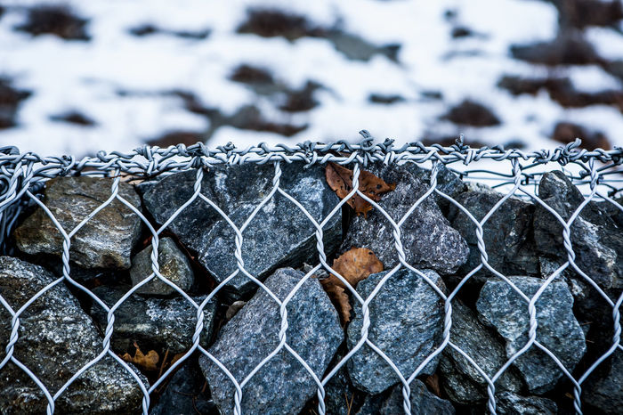Bad Condition Barbed Wire Broken Chain Chainlink Fence Close-up Deterioration Fence Focus On Foreground Geometry Hanging Metal Metallic No People Pattern Protection Riverside Rock Rusty Safety Security Snow Winter