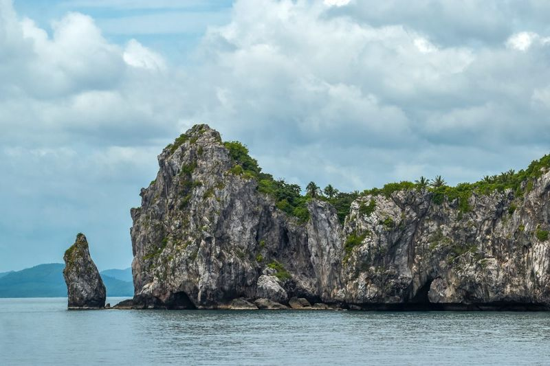 Cloud - Sky Sky Water Sea Nature Beauty In Nature Rock Rock Formation Solid Land No People Tranquil Scene Tranquility Non-urban Scene Waterfront Scenics - Nature Rock - Object Mountain Outdoors Day