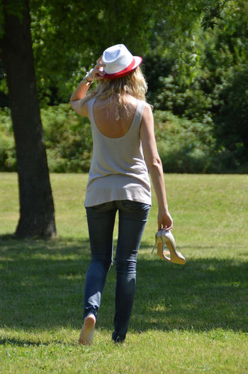 Full length of woman standing in park