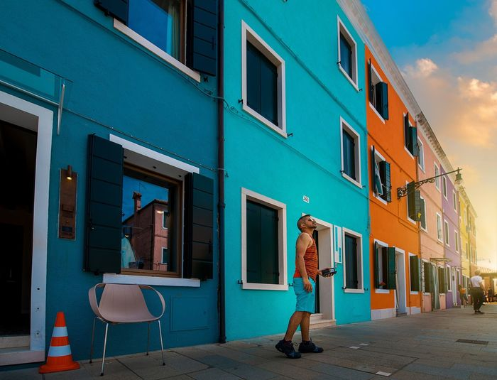enjoying the Colors of Burano , Italy Italian Italy Burano Town Colorful City Multi Colored Business Finance And Industry Store Window Awning Sky Architecture Building Exterior Built Structure First Eyeem Photo