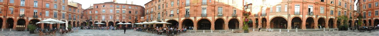 Place nationale Montauban France Getting InspiredPanoramic Photography Architecture Building Exterior Built Structure Large Group Of People Spirituality Person Religion Cathedral Arch Travel Destinations Place Of Worship Tourism City City Life Outdoors Famous Place Arcade In Front Of Milan Cathedral Sky Battle Of The Cities