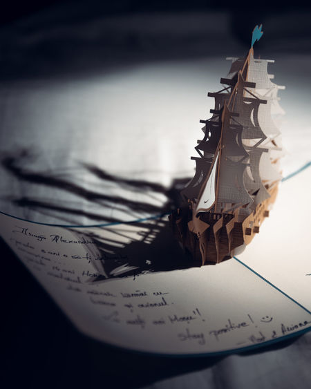 Paper Boat EyeEm Best Shots EyeEmNewHere EyeEm Nature Lover EyeEm Selects EyeEm Gallery Nikon D750 Concept Conceptual Focus On Background Sharp Dark Photography Moon Surface Tripod Toronto Ontario Canada Canadian Best  Fresh New Paper Close-up No People Still Life Focus On Foreground Western Script Two Objects Creativity Communication Text Boat Togetherness Toy