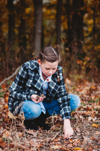 Land Forest Autumn One Person Real People Change Casual Clothing Nature Tree Child Males  Leisure Activity Childhood Men Focus On Foreground Leaf Lifestyles Plant Part Day Outdoors WoodLand Leaves Innocence Pre-adolescent Child Teenager
