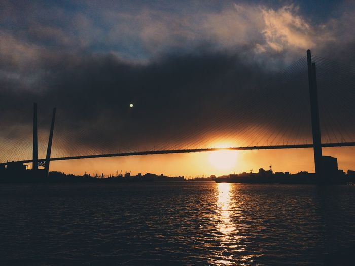 Sunset Water Sky Nature No People Cloud - Sky Silhouette Waterfront Outdoors Beauty In Nature Sea Scenics Sun Architecture Day City Light And Shadow Built Structure Bridge Sunset_collection Reflection