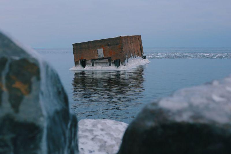 Sunken building in sea