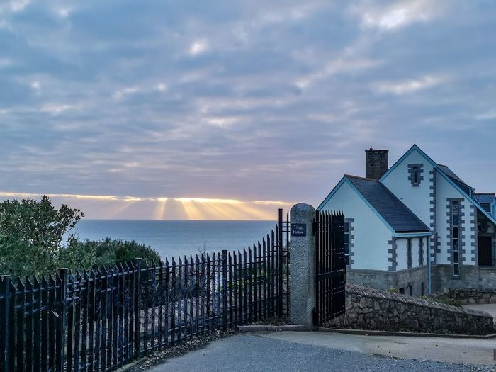 light shining down Harbour Town Cornish Views Sunset Nature Sea Water Beach Sand Sky Architecture Building Exterior Horizon Over Water Built Structure Cloud - Sky Fence Gate Calm Residential Structure