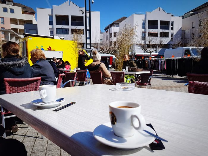 Sunny morning Sunnyday☀️ Coffee Time Coffee And Sunlight Marketplace people and places Yellow Color Blue Sky Drink Cafe Coffee - Drink Table Coffee Cup Sky Building Exterior
