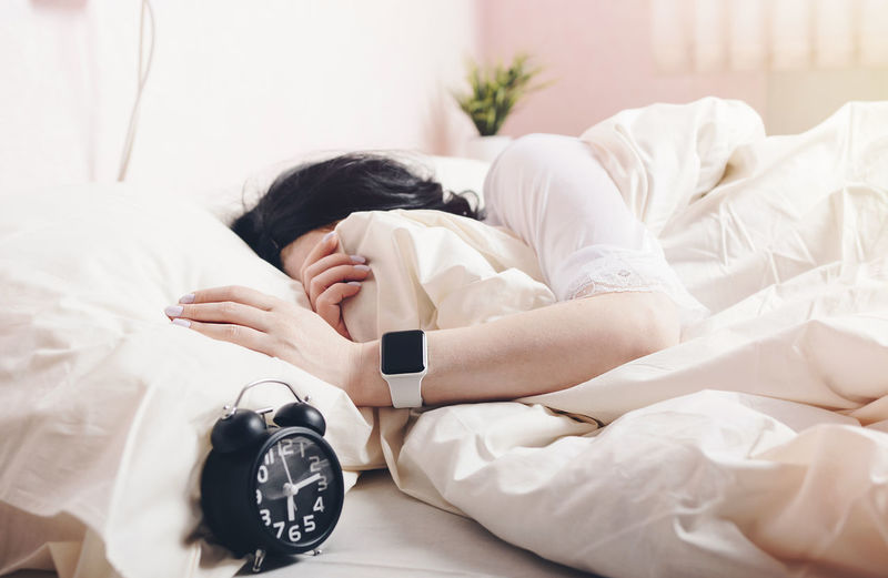 Girl on a white bed with alarm clock and smart watch on the hand Girl Morning White Color Lifestyles Tired Adult Relaxation Real People Furniture Hand Young Women Women Young Adult Resting Lying Down Clock Indoors  Sleeping Alarm Clock One Person Time Bed Smart Watch Apple International Women's Day 2019 My Best Photo