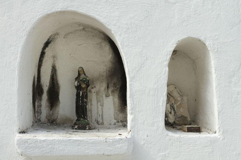 a Catholic saint statue on a gravestone Cemetery Cemetery Photography Devotion Faith Matchbox Cemetery_shots Faith&devotion No People Saint White Color