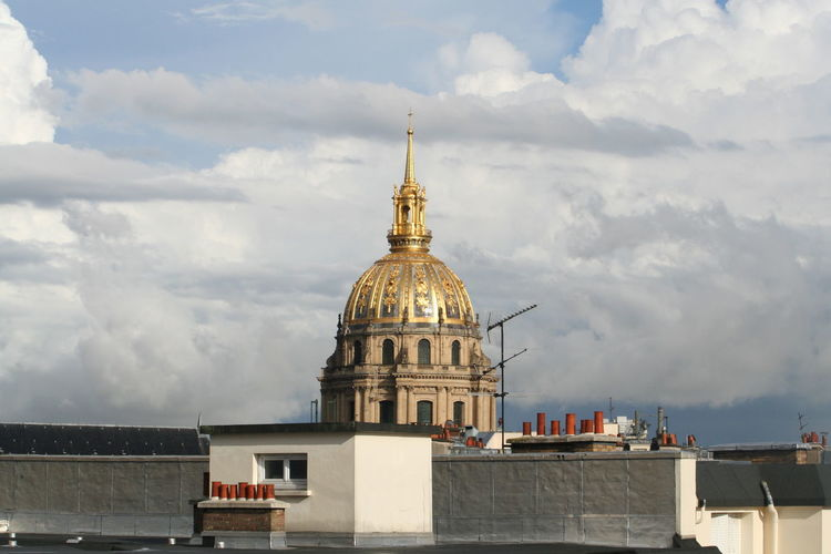 St-louis-des-invalides against cloudy sky in city