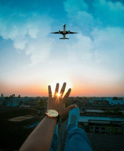 Live For The Story Airplane Human Hand Cloud - Sky Mid-air Flying Silhouette Human Body Part Sky One Person Journey Air Vehicle One Man Only People Adult Sunset Adults Only Only Men Outdoors Technology Day The Street Photographer - 2017 EyeEm Awards The Great Outdoors - 2017 EyeEm Awards EyeEm Best Shots WeekOnEyeEm