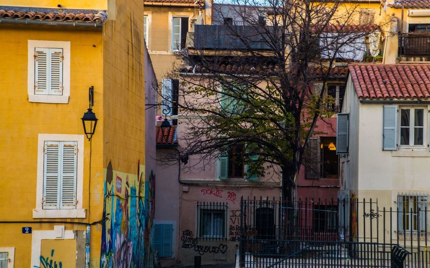marseille,le panier,bouche du rhone,france Building Exterior Architecture Built Structure Building Residential District City Window No People Tree House Plant Outdoors Day Low Angle View Nature Yellow Town Street Bare Tree Roof Apartment Location Place